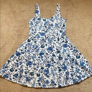 Adorable white dress with blue flower design